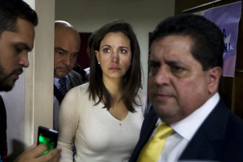 Venezuelan opposition lawmaker Machado arrives at a news conference after a fight in parliament in Caracas